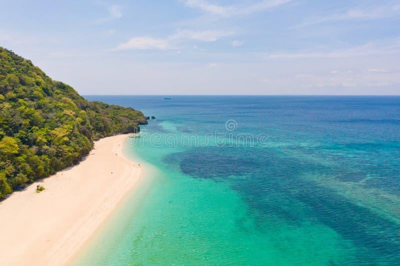 Puka Shell Beach. Wide tropical beach with white sand. Beautiful white beach and azure water on Boracay island royalty free stock image