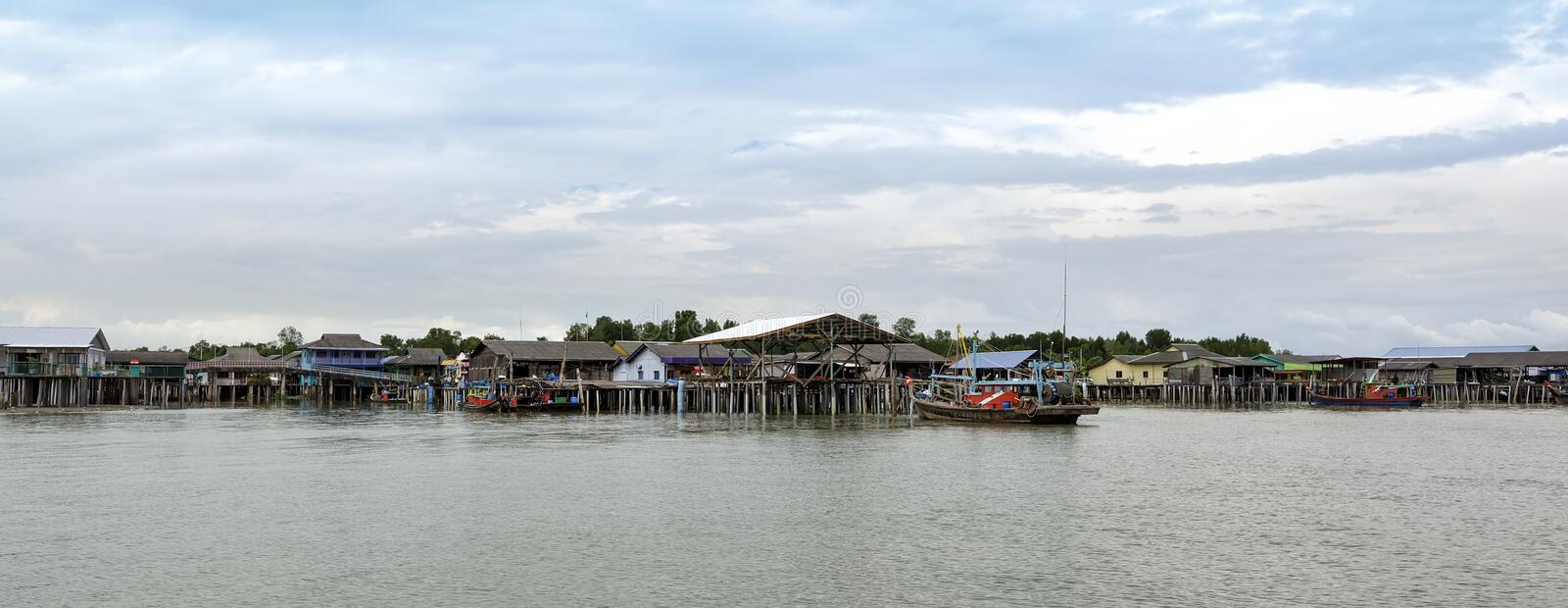 A view of a fishermen`s village besides the sea at Bagan Sungai Lima of Pulau Ketam Crab Island, Malaysia. stock photography