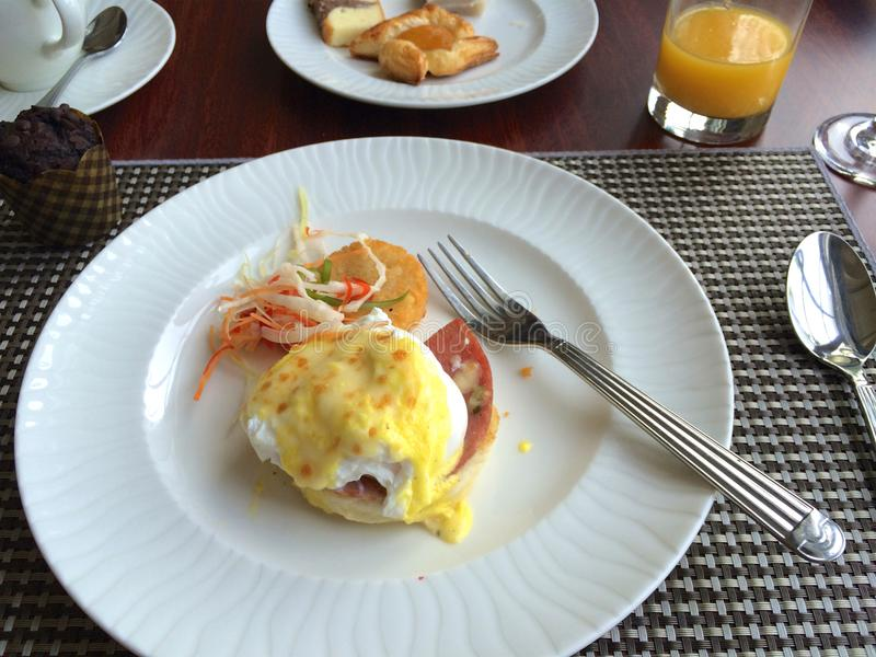 PULAU LANGKAWI, MALAYSIA - APR 6th 2015: Eggs Benedict is a traditional American breakfast or brunch dish with bacon stock photos