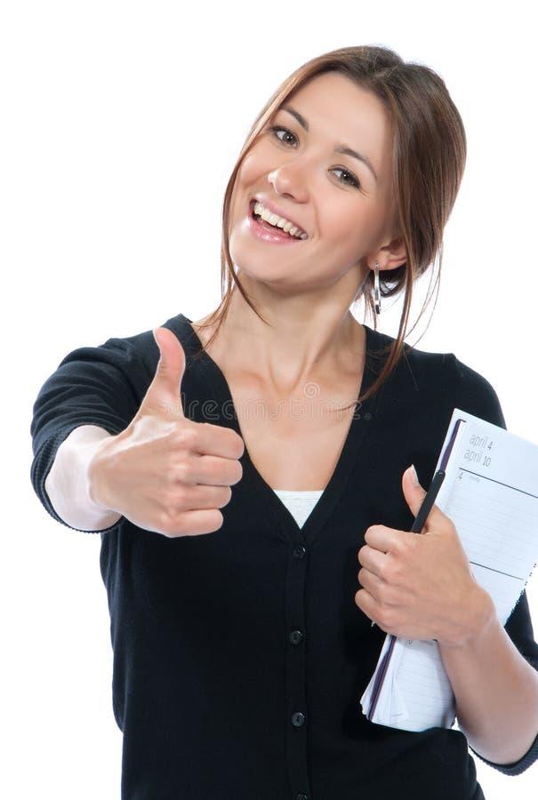 Pulgar bonito de la mujer de negocios para arriba, sonriendo fotografía de archivo libre de regalías