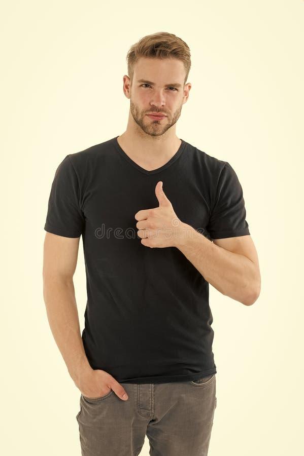 Pulgar cl?sico de la demostraci?n del peinado del hombre barbudo encima del gesto de mano Hombre con el pelo elegante y la piel s foto de archivo