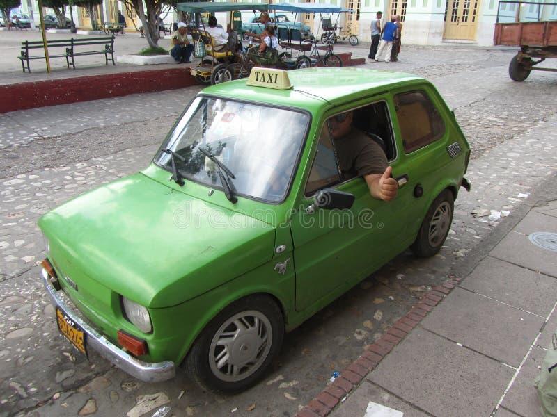 Pulgar cubano típico del taxi y del taxista fotos de archivo libres de regalías