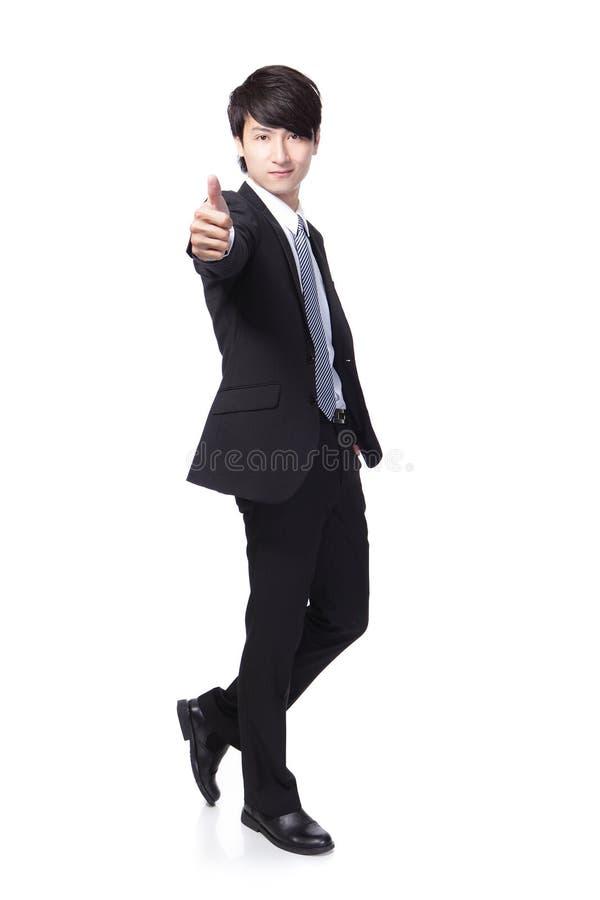 Pulgar de la demostración del hombre de negocios para arriba en integral fotos de archivo