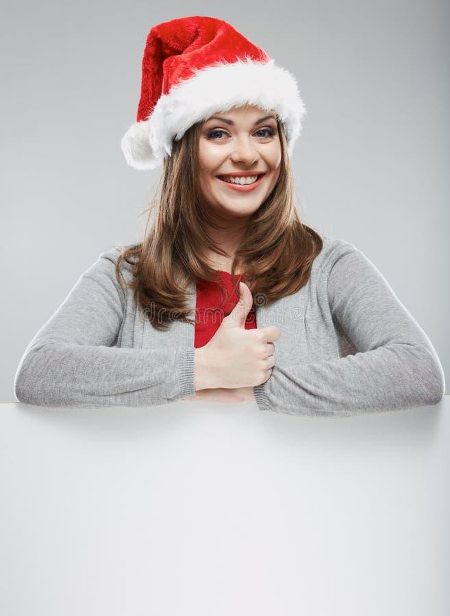 Pulgar de la demostración del retrato de la Navidad de la mujer de Papá Noel para arriba fotos de archivo