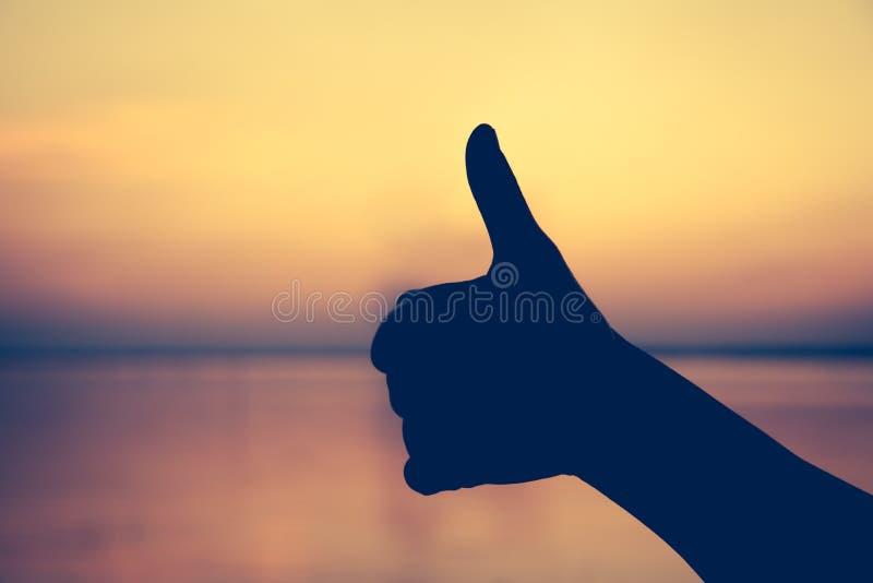 Pulgar de la mano para arriba Gesto de la mano El símbolo es malo a bueno, como imagenes de archivo
