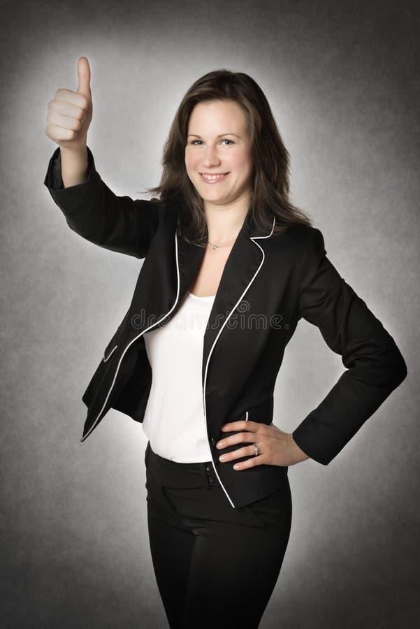 Pulgar de la mujer de negocios para arriba imagen de archivo