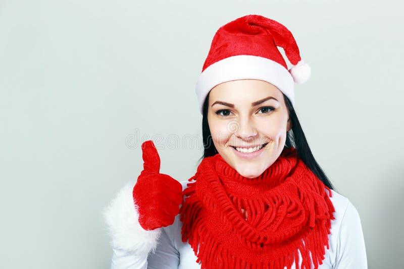 Pulgar de la mujer de Papá Noel foto de archivo libre de regalías