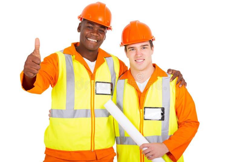 pulgar de los trabajadores de construcción para arriba imagen de archivo libre de regalías