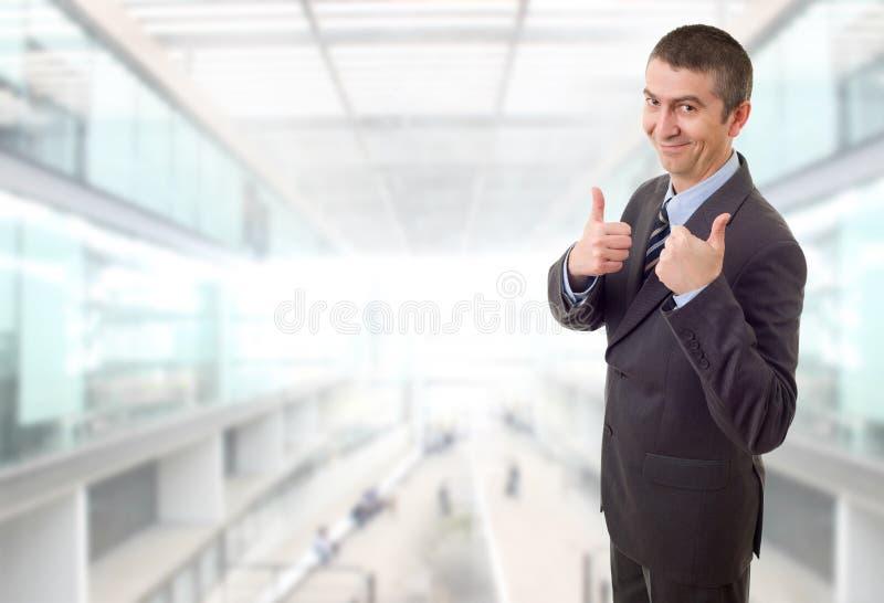 Pulgar del hombre de negocios para arriba foto de archivo
