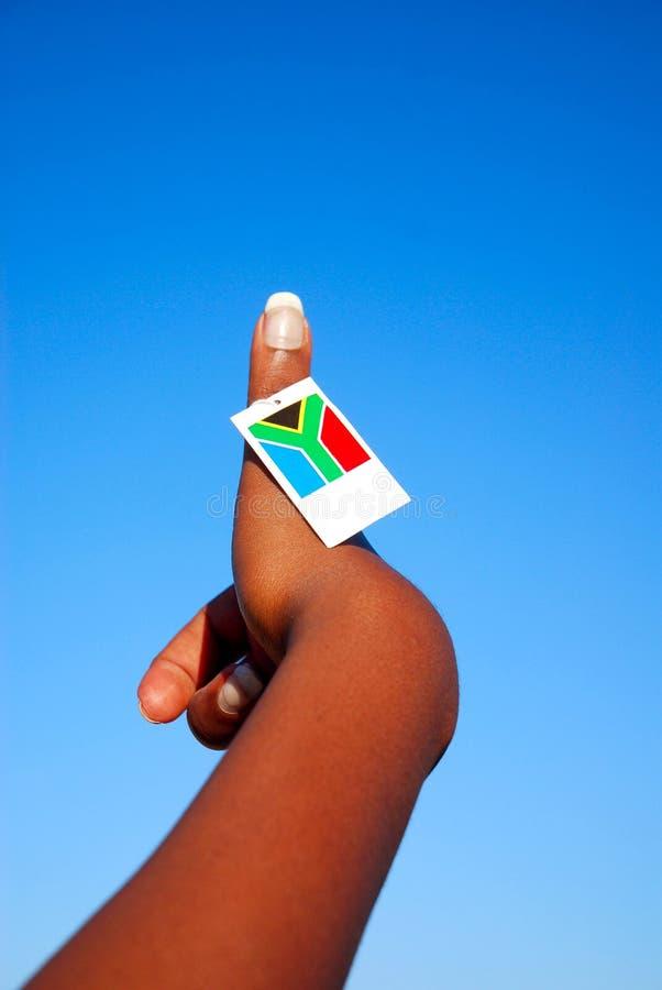 Pulgar del indicador de Suráfrica para arriba imagen de archivo