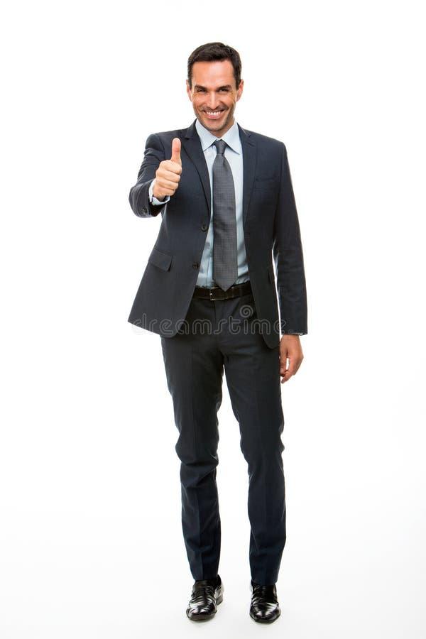 Pulgar sonriente del hombre de negocios para arriba foto de archivo