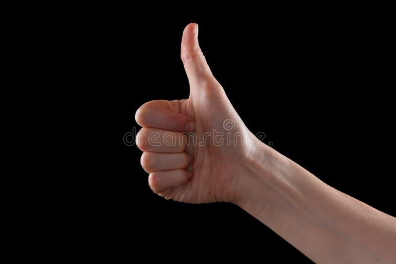 Pulgares de la aprobación para arriba como la muestra como gesto de mano caucásico aislada sobre negro imagen de archivo libre de regalías