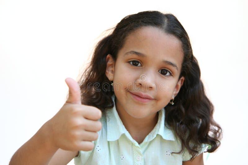 Pulgares de la chica joven para arriba fotografía de archivo