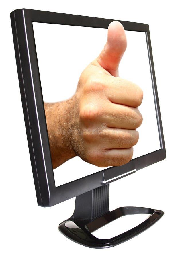 Pulgares para arriba en monitor imagen de archivo libre de regalías