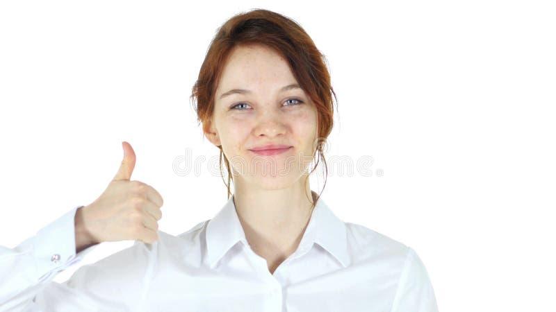 Pulgares para arriba, mujer roja del pelo en el fondo blanco fotografía de archivo libre de regalías