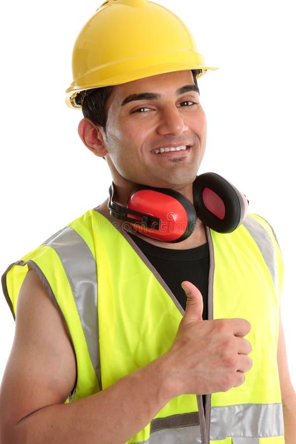 Pulgares sonrientes del constructor para arriba imagen de archivo libre de regalías