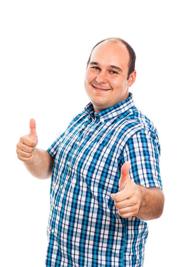 Pulgares sonrientes del hombre para arriba imagen de archivo