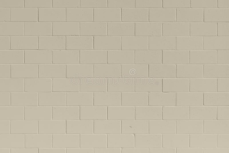 Pulisca il fondo generico della parete del blocchetto di cenere del mattone di abbronzatura fotografia stock libera da diritti