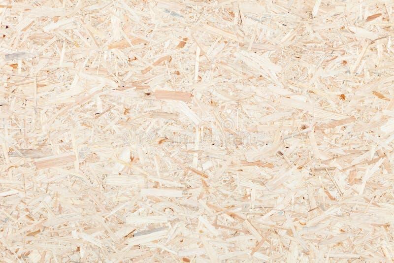 Pulisca la superficie del pannello truciolare di legno Struttura del bordo di legno compresso delle scalpellature immagine stock