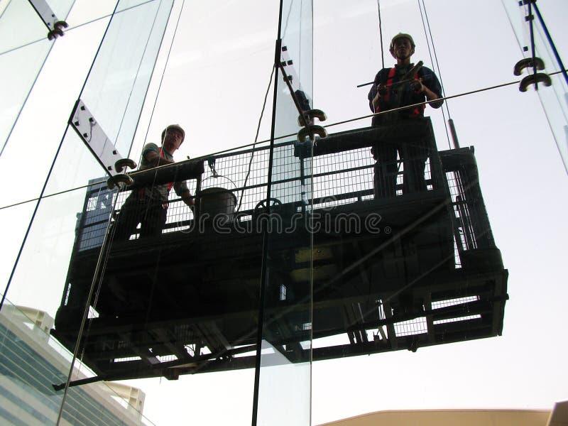 Pulitori di finestra fotografie stock