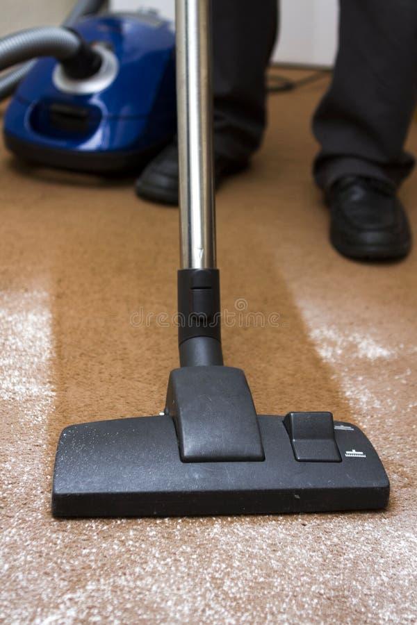 Pulizia del tappeto immagine stock