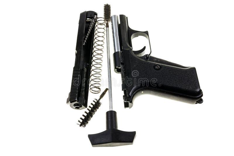Pulizia della pistola fotografia stock