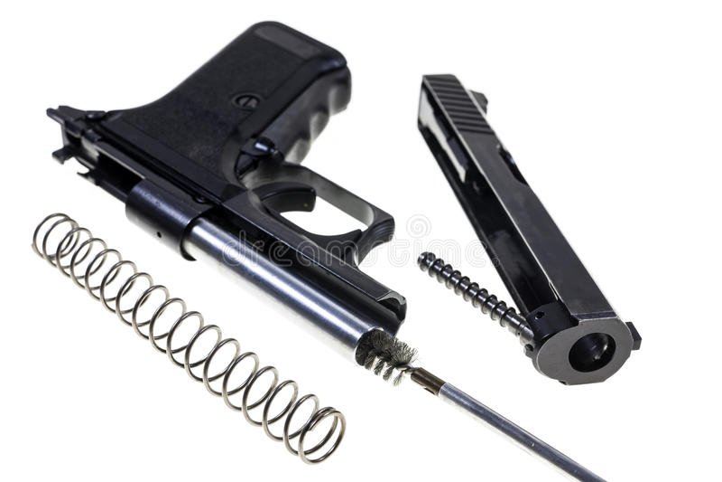 Pulizia della pistola fotografia stock libera da diritti