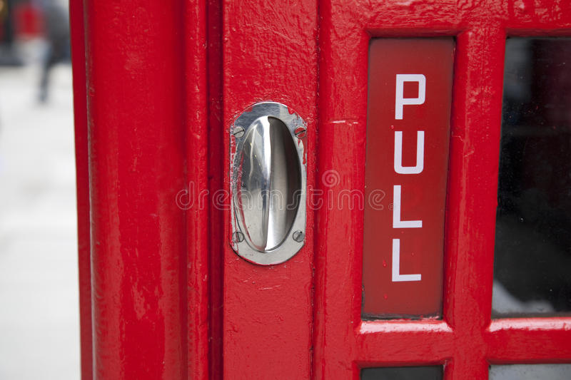 Pull Door Sign. Red Telephone Box Pull Door Sign, London royalty free stock images