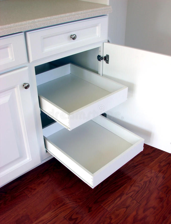 Pull Out Kitchen Drawers Shelves in a Modern House royalty free stock photos