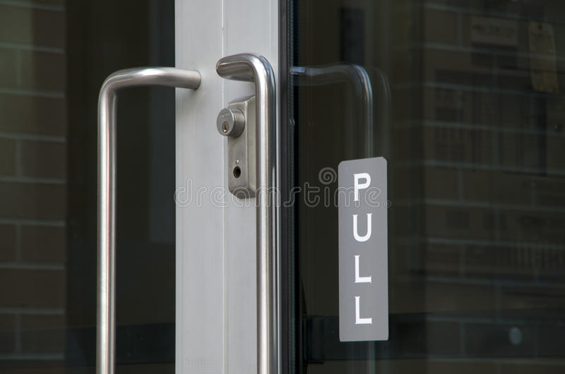 Pull sign at glass door. A nice sign at a new glass door stock photography