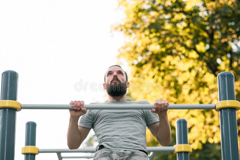 Pull ups training strength exercising athletic man. Pull ups. man training. strength and power exercising. athletic lifestyle royalty free stock photography