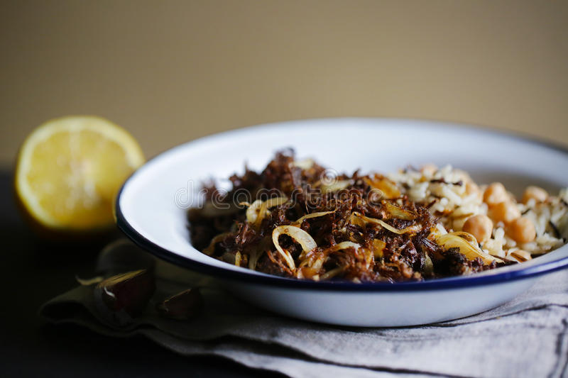 Pulled beef meat with wild rice and chickpeas, cuban cuisine royalty free stock photos