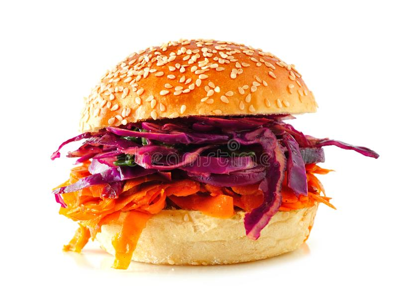 Healthy, plant based meatless pulled carrot burger isolated on a white background. Pulled carrot meatless burger with red cabbage slaw isolated on a white stock image