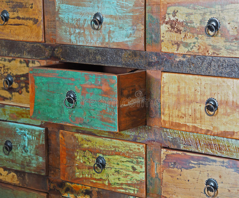 Pulled drawer on old wooden colorful dresser royalty free stock images