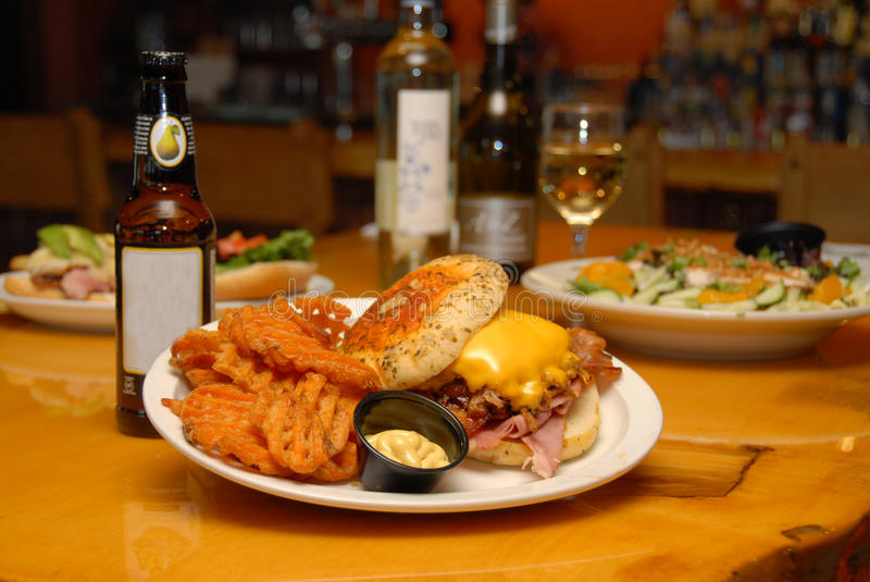 Pulled pork with ham & cheese pub & grill meal stock photography