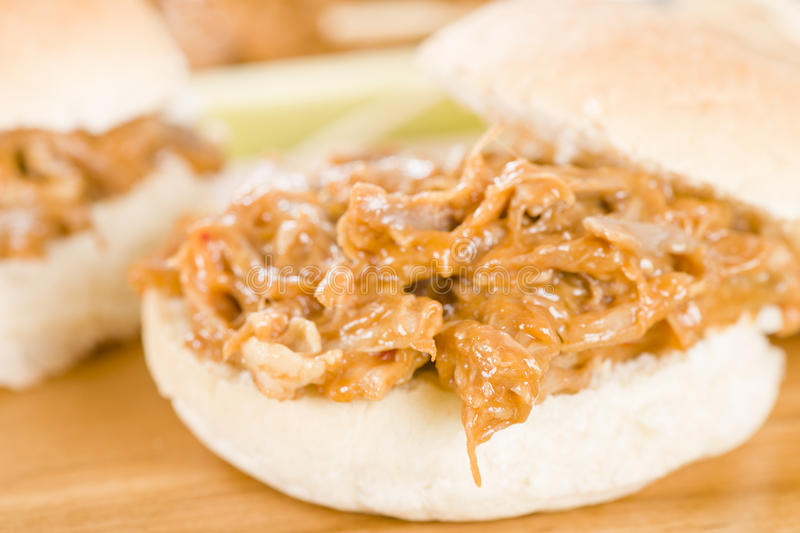 Pulled Pork Slider. Juicy slow roasted pork meat in a white bun stock photos