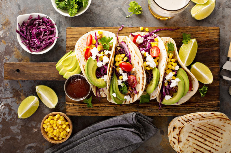 Pulled pork tacos with red cabbage and avocados stock photography