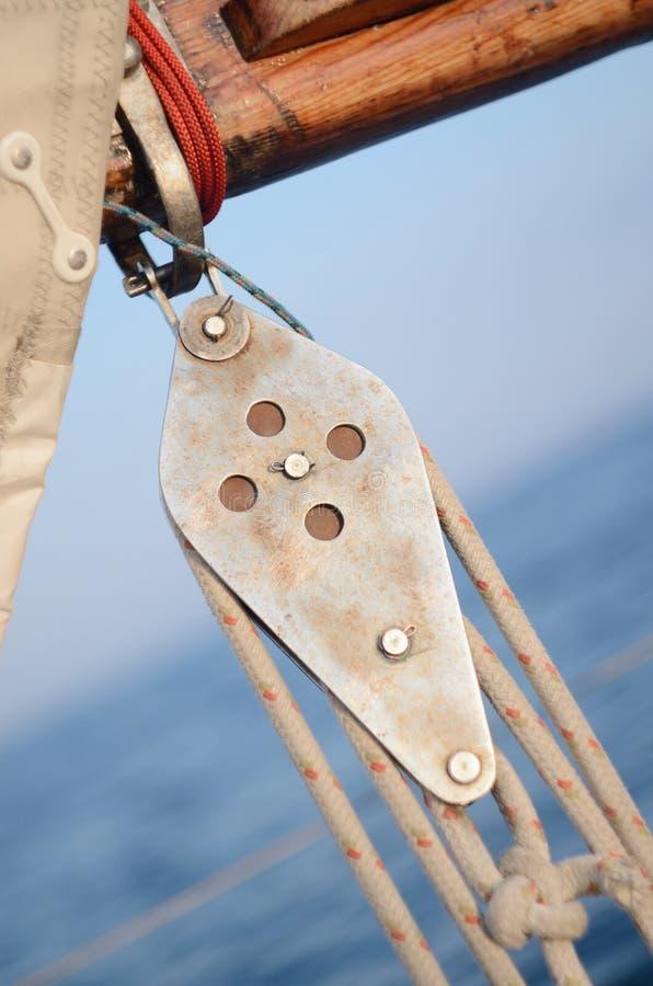 Pulley Blocks of mainsheet, running rigging of vintage yacht stock photos