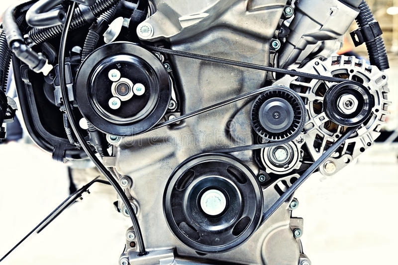 Pulleys with belt in the car motor royalty free stock image