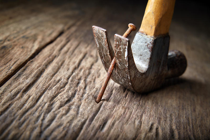 Pulling out rusty nail royalty free stock photos