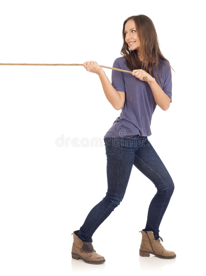 Pulling a rope royalty free stock photo