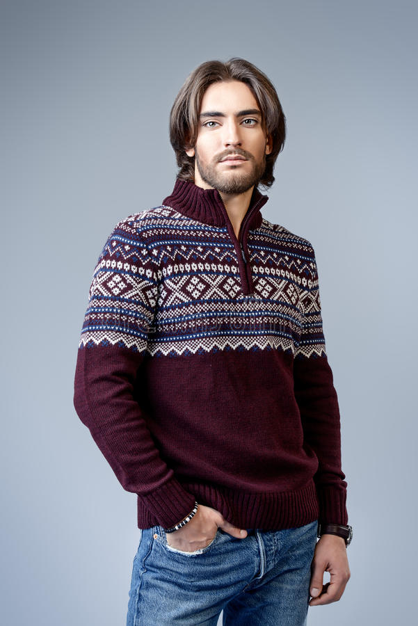 Pullover with ornament. Handsome man wearing winter pullover. Men`s beauty, fashion. Hairstyle for men. Studio shot stock photos