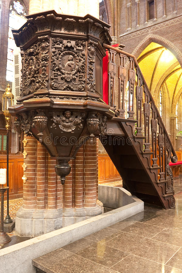 Pulpit of oak wood. Detailed and rich decorated pulpit, made of oak wood. A beautiful woodcarving stock images