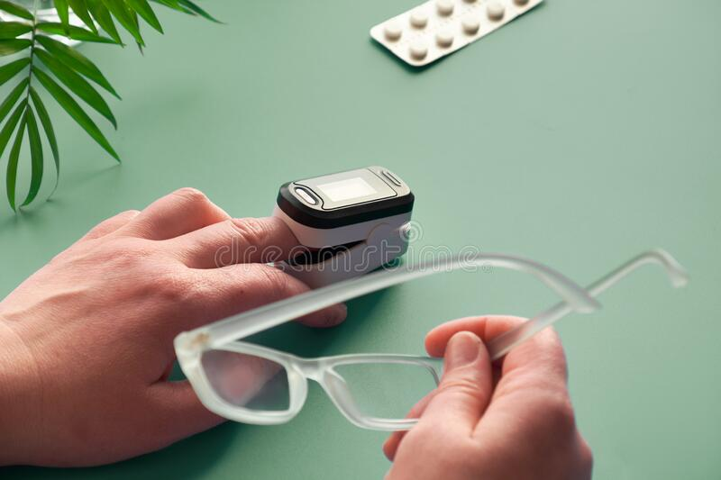 Pulse Oximeter portable digital device to measure person`s oxygen saturation. Reduction in oxygenation is an emergency sign of. Pulse Oximeter portable digital royalty free stock photo