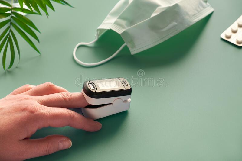Pulse Oximeter portable digital device to measure person`s oxygen saturation. Reduction in oxygenation is an emergency sign of. Pulse Oximeter portable digital stock images