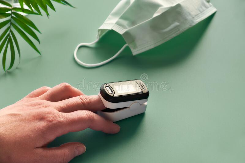 Pulse Oximeter portable digital device to measure person`s oxygen saturation. Reduction in oxygenation is an emergency sign of. Pneumonia requiring urgent royalty free stock photography