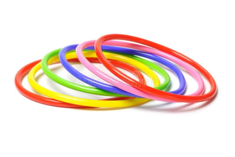 Pulseira plásticas coloridas imagem de stock