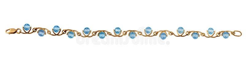 Pulsera de oro de la joyería con el topaz azul imágenes de archivo libres de regalías