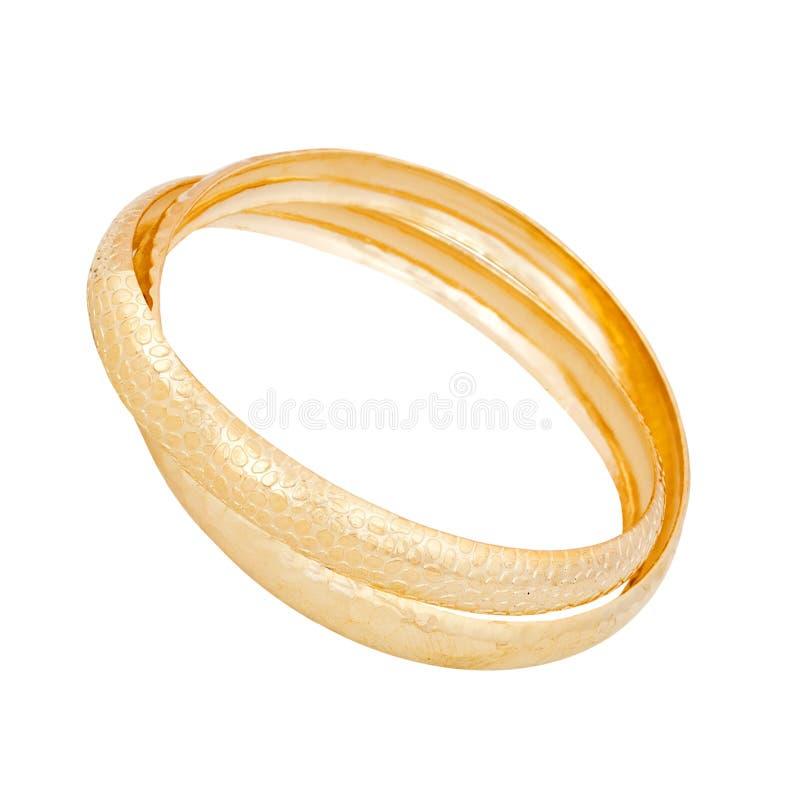 Pulsera del oro en un blanco foto de archivo