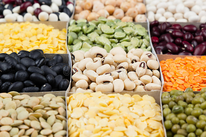 Pulses food background, assortment - legume, kidney beans, peas, lentils in square cells macro. Healthy protein food stock photos